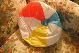 beach ball on beach. A Deflated Beach Ball Used As Wedge Pillow. On