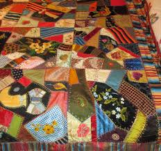 Museum Quality & Antique Quilt 6535. Crazy Quilt in silks, satins, striped border dated  1882. Hand quilted with red silk back, heavy cording and tassels, heavily  embroidered ... Adamdwight.com