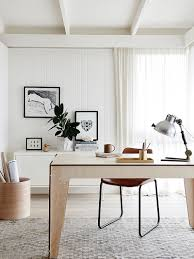 white scandinavian home office with a hint of black from plyroom black and white home office