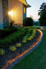 driveway curb lighting. lighted edging with rope light or maybe you could use led christmas lights. driveway curb lighting