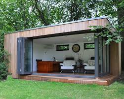 prefabricated garden office. garden lodge with fullyopening bifold doors prefabricated office
