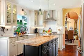 granite countertops and backsplash traditional u shaped dark wood floor farmhouse sink raised panel cabinets white