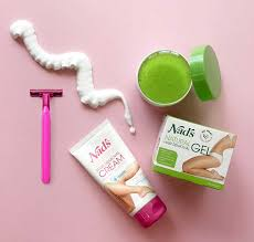 nad s sensitive hair removal cream and natural hair removal gel s and packaging on table with
