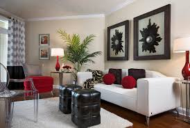 Living Room. . White Lounge With Red And Black Cushions Plus Glass Chair  And Black