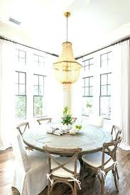 cafe style dining room dining room tables chic cottage features a gold beaded chandelier hanging over