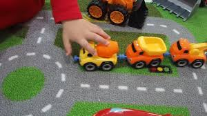 nick plays with lightning mcqueen and friends on his ikea rug