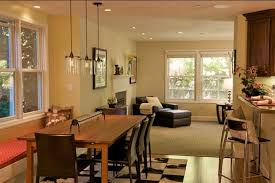 checkerboard rug for simple dining room ideas with glass light fixtures and leather chairs