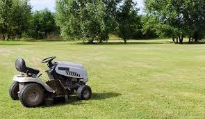 best garden tractor tractor on a fresh cut lawn