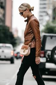 blonde woman wearing tan leather moto jacket black ripped skinny jeans outfit chloe drew handbag fashion