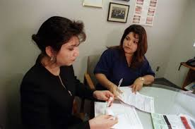 an allstate insurance agent left works with a client in houston allstate insurance