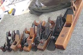 antique wooden hand planes. from left to right is a stanley transitional jack, 36 razee smoother, and an old ohio tool coffin smoother. antique wooden hand planes b