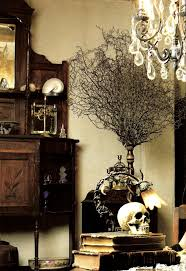 Dark walnut stained wood, skull, and old books as home decor. In the spirit  of Halloween!