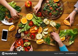 kitchen table with food. Dinner Table, Women Eat Healthy Food At Home Kitchen \u2014 Stock Photo Table With