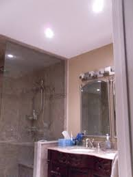 recessed lighting for bathrooms. mini recessed ceiling lighting by bathroom sink and mirors using low wattage par 20 led light for bathrooms