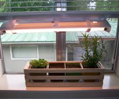 simple indoor herb garden with adjule grow light