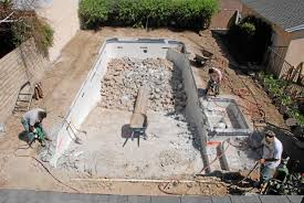 workers use jackhammers to break up the concrete in pool phil and cil riverau0027s granada hills backyard filling a swimming k77