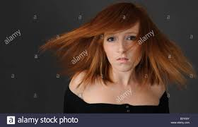 redhead auburn hair on a young stock image
