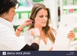s clerk helping customer in store stock photo royalty s clerk helping customer in store