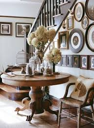 entryway round table ideas below large decorative pine cones inside gl domed display cases beside pedestal bird cage across framed old pictures also
