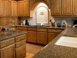 wooden kitchen with granite worktop