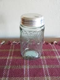 This pale green glass Pint Mason Jar Sugar Dispenser has a tin lid ... & Pint mason jars Adamdwight.com