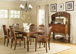 Classic Brown Stained Wooden Dining Table Under Black Wrought Iron Solid Wood Formal Dining Room Sets