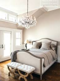 french style beds and french style bedroom with upholstered linen bed and ornate crystal chandelier so