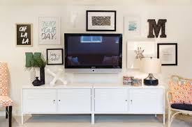 Wall Mount Tv For Living Room Gallery Wall Incorporates Mounted Tv Hgtv Home Pinterest