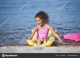 African american girl on inflatable mattress u2014 Stock Photo 160969278