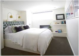 interesting white bedding for tiny basement bedroom ideas with bright lighting and white shelves basement bedroom lighting ideas
