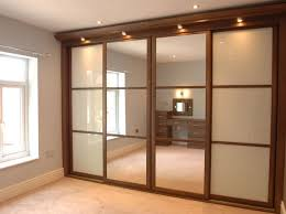 custom made sliding door wardrobes in a choice of colours with bespoke interiors designed and