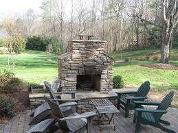 attractive backyard fireplace plans with wooden patio flooring and relaxing outdoor furniture plans and beautiful forest background view from modular