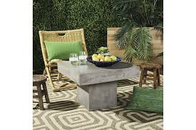 Safavieh pacey rectangle outdoor coffee table 39 4 in w x 19 7 l the patio tables department at com. Tallen Indoor Outdoor Modern Concrete Coffee Table Ashley Furniture Homestore