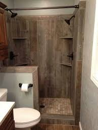 Ceramic tile that looks like barn wood. Small bathroom, living large:  corner shelves, double shower heads, pony wall to separate toilet.