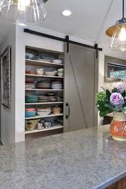 view in gallery barn door pantry offers plenty of storage e for chinaware design robert paige cabinetry
