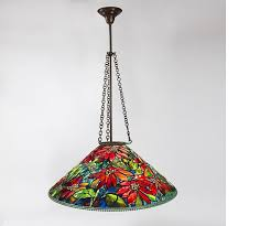 a tiffany studios new york glass and bronze poinsettia chandelier featuring a leaded