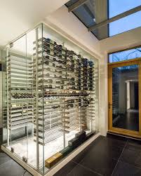 Custom modern glass surround wine cellar designed and constructed by Papro  Consulting www.paproconsulting.