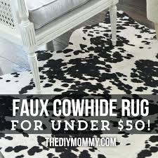 faux cowhide rugs cowhide rug for under via the mommy faux cowhide rugs contemporary