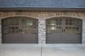 glass garage doors accent the home with a modern touch and can be fully customized to meet your specific needs
