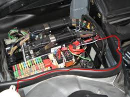 wiring wtf page  starting from the washer fluid cap the wiring runs inside the black insulator and then through main wiring grommet and up through the fuse box