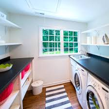 view in gallery bright red baskets on laundry room shelving