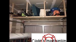 the garage doorOver the Garage Door Wood Storage Shelves  YouTube