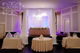 a crystallized cream voile canopy with hanging chandelier front view