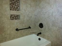decorative grab bar in bathtub surround with tile walls