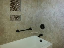 decorative grab bar in bathtub surround with tile walls