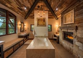 covered porches with fireplaces bathroom rustic with wall sconces fireplace in bathroom