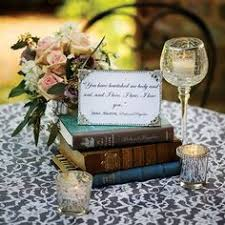 simple books place a stack of leather bound books on each table topped with a framed e from one of the clic literary picks