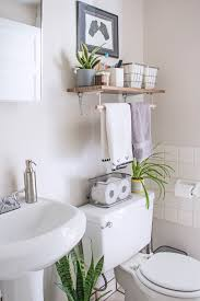 apartment bathroom solutions use contact paper to dress up ugly shelving