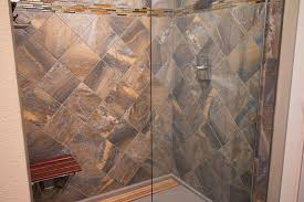 tiled shower with stone and glass mosaic accents by precision floors and decor plymouth