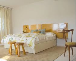 Inspiration for a modern bedroom remodel in Miami with beige walls